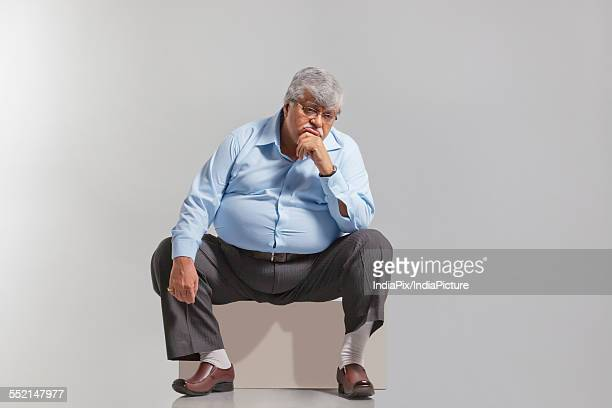 Obese old man feeling sad