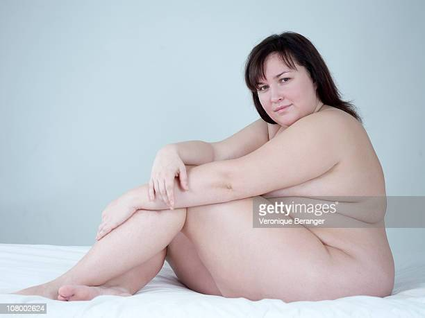 obese woman's nude - chubby woman stock-fotos und bilder