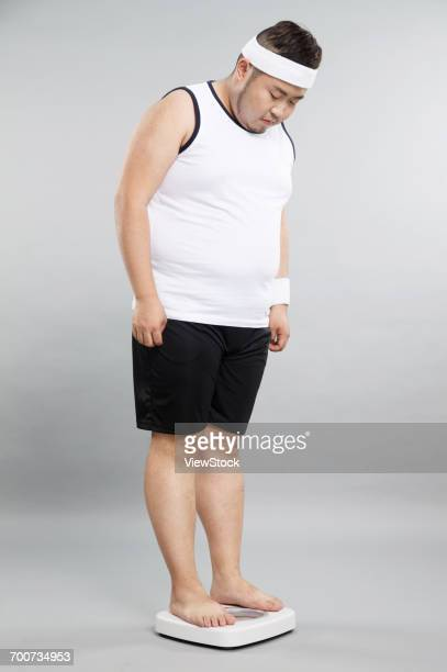 Obese young men weigh weight