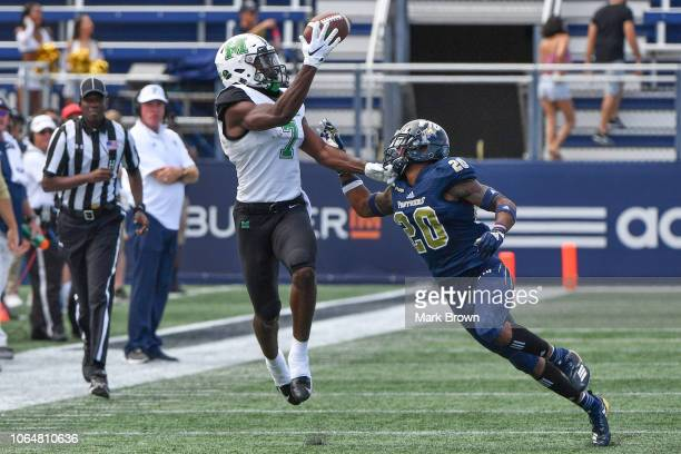 Obi Obialo of the Marshall Thundering Herd makes a catch in the first half against the FIU Golden Panthers at Ricardo Silva Stadium on November 24...