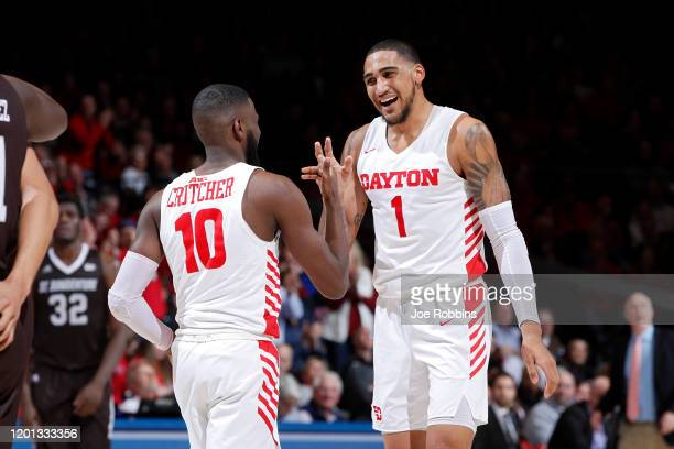 Obi Toppin and Jalen Crutcher of the Dayton Flyers celebrate in the second half of the game against the St Bonaventure Bonnies at UD Arena on January...