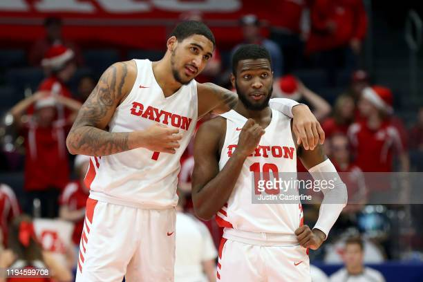 Obi Toppin and Jalen Crutcher of the Dayton Flyers chat during the game against the North Texas Mean Green during the second half at UD Arena on...