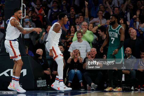Obi Toppin and RJ Barrett of the New York Knicks react as Jaylen Brown of the Boston Celtics looks on during the second half at Madison Square Garden...