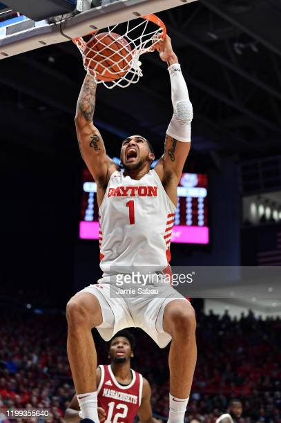 Obi Toppin of the Dayton Flyers controls the ball against the Massachusetts Minutemen on January 11 2020 at UD Arena in Dayton Ohio Dayton defeated...