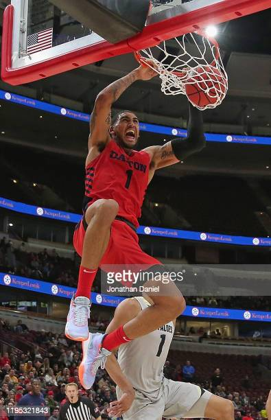 Obi Toppin of the Dayton Flyers dunks over Tyler Bey of the Colorado Buffaloes at the United Center on December 21 2019 in Chicago Illinois Colorado...