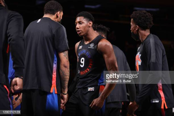 Obi Toppin of the New York Knicks greets RJ Barrett of the New York Knicks during the game against the Memphis Grizzlies on April 9, 2021 at Madison...