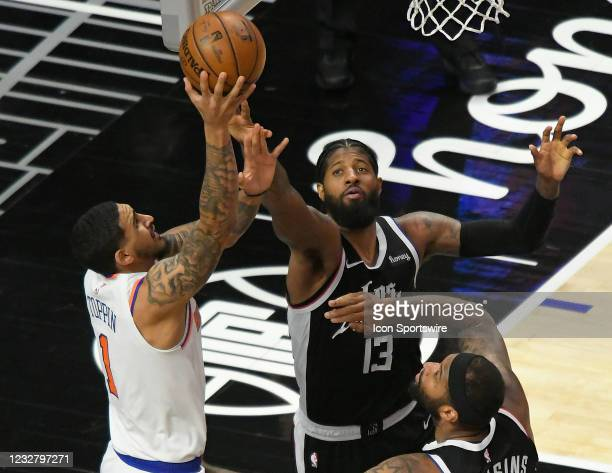 Obi Toppin of the New York Knicks shoots over Paul George and DeMarcus Cousins of the LA Clippers in the second half during the Los Angeles Clippers...