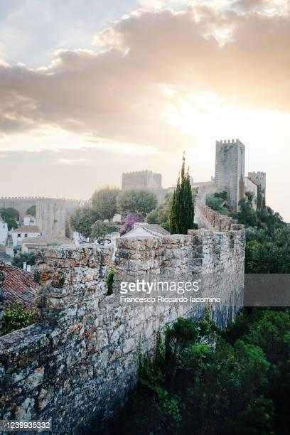 obidos at dusk, beautiful medieval villages in portugal. - iacomino portugal foto e immagini stock