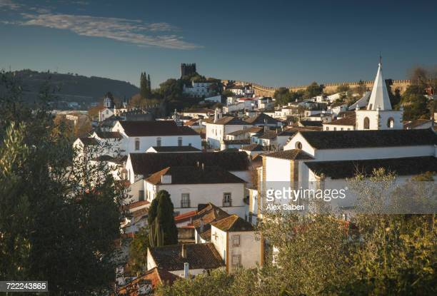 'Sunrise over the roofs of Obidos, Portugal.'