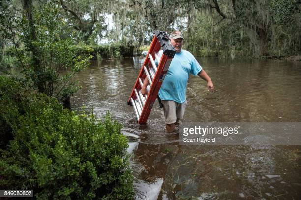 Obie Lands begins clean up at his home inundated by flood waters caused by Hurricane Irma September 12 2017 near Palatka Florida Millions of people...
