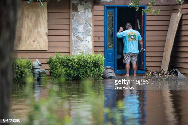 Obie Lands begins clean up at his home inundated by flood waters caused by Hurricane Irma September 12 2017 near Palatka Florida The storm brought...