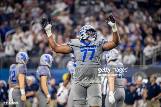 Obinna Eze of the Memphis Tigers reacts to a field goal during the Goodyear Cotton Bowl Classic at ATT Stadium on December 28 2019 in Arlington Texas