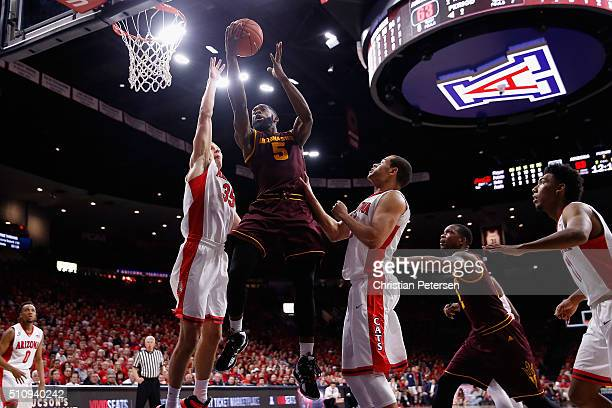 Obinna Oleka of the Arizona State Sun Devils attempts a shot over Kaleb Tarczewski of the Arizona Wildcats during the second half of the college...