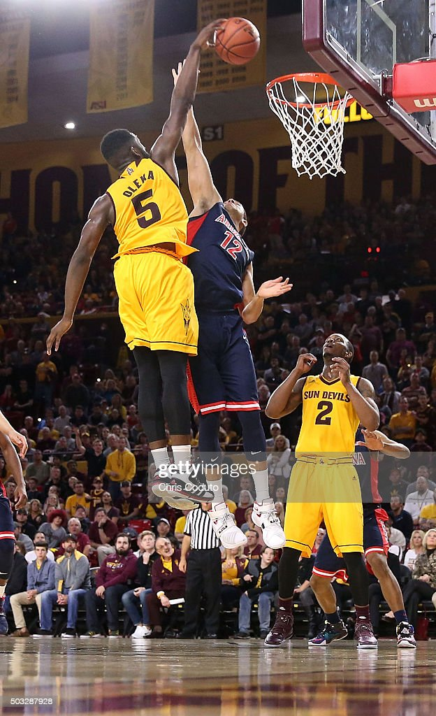 Obinna Oleka #5 of the Arizona State Sun Devils dunks over Ryan Anderson #12 of the Arizona Wildcats during the second half of the college basketball game at Wells Fargo Arena on January 3, 2016 in Tempe, Arizona. The Arizona Wildcats beat the Arizona State Sun Devils94-82.