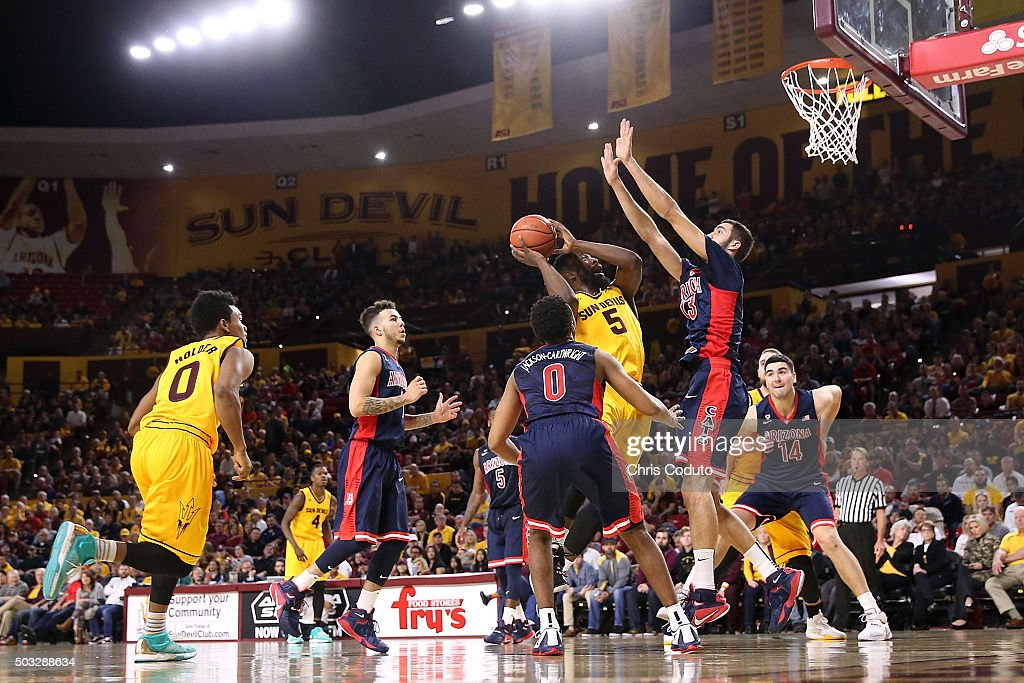 Obinna Oleka #5 of the Arizona State Sun Devils is defended by Mark Tollefsen #23 of the Arizona Wildcats (right) during the second half of the college basketball game at Wells Fargo Arena on January 3, 2016 in Tempe, Arizona. The Arizona Wildcats beat the Arizona State Sun Devils 94-82.