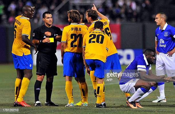 Obinze Angelo Ogbonna of team Juventus receives a yellow card during the Guinness International Champions Cup at ATT Park in San Francisco Calif on...