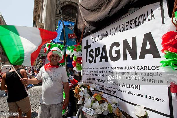 Obit placard for the Spanish football team is displayed with flowers showing the colors of the Italian national flag in a street of the southern...