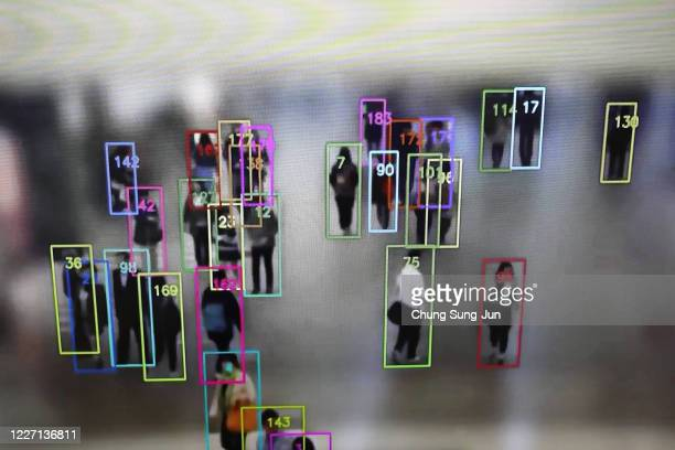 Object detection and tracking technology for people not wearing masks developed by SK Telecom is displayed on a screen at the company headquarters on...