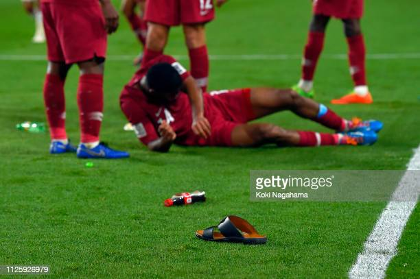 Objects are thrown onto the pitch after Qatar score their third goal during the AFC Asian Cup semi final match between Qatar and United Arab Emirates...