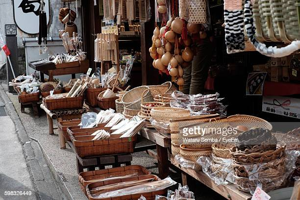 objects at display on street market stall - narita stock photos and pictures