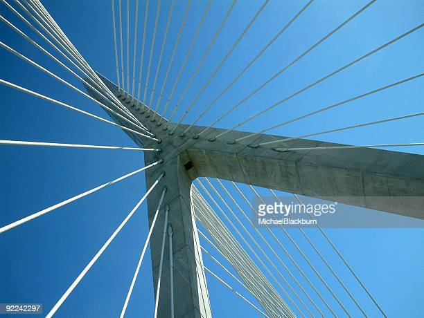objects - cables and supports against blue sky - suspension bridge stock photos and pictures
