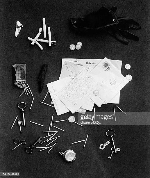 objects from the trouser pocket of a messy person eg matches coins keys letters cigarettes 1907Vintage property of ullstein bild