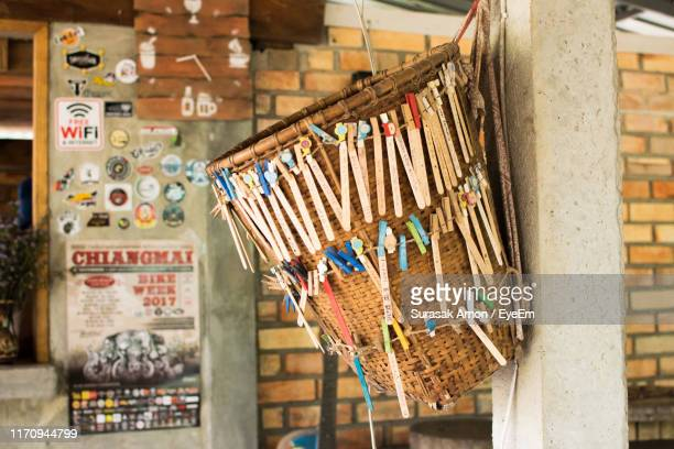 objects hanging on basket for sale at market - for stock pictures, royalty-free photos & images