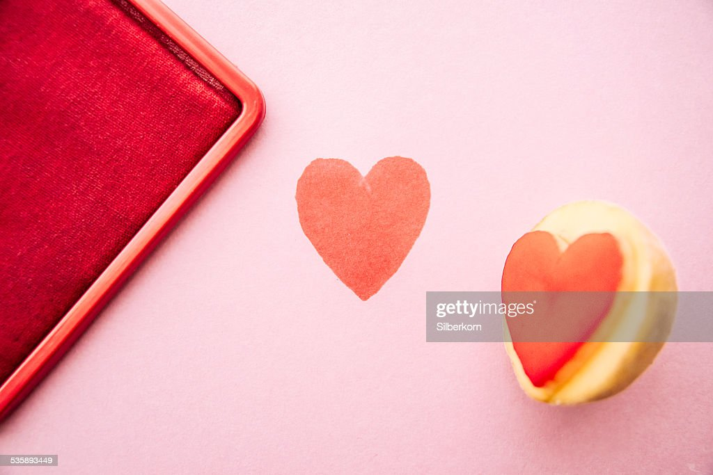 Objects: Heart shaped potato stamp on pinkpaper : Stockfoto