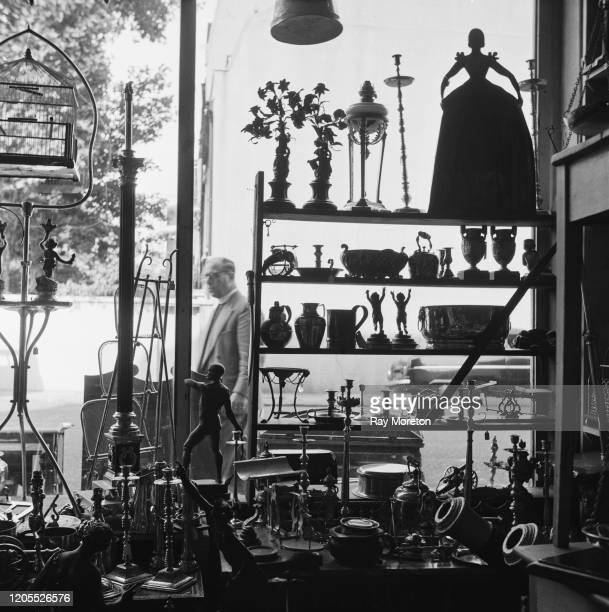 Objects in the window of an antique shop in Chelsea London September 1959