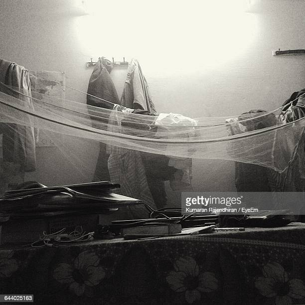 Objects On Bed With Mosquito Netting At Home