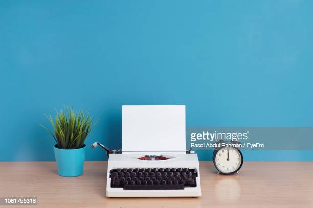 objects on table against wall - typewriter stock pictures, royalty-free photos & images