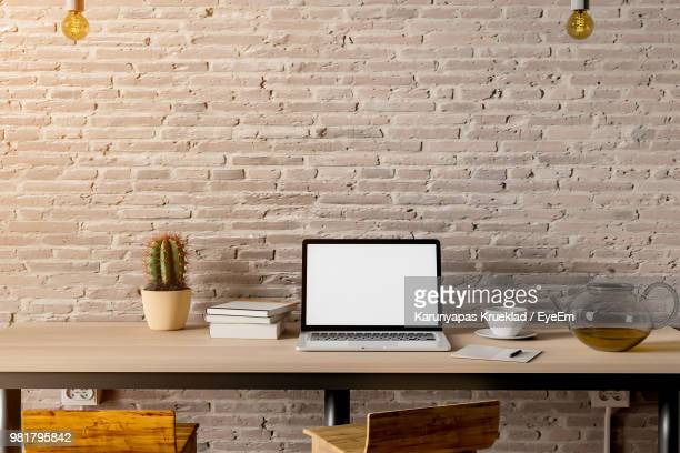 Objects On Table Against Wall