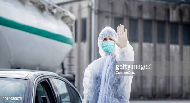 obligatory body temperature control on the country border - state of emergency stock pictures, royalty-free photos & images