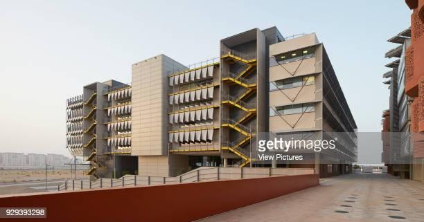 Oblique elevation in context. Siemens Masdar, Abu Dhabi, United Arab Emirates. Architect: Sheppard Robson, 2014.