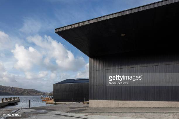Oblique elevation of facade with overhang towards lake. Windermere Jetty Museum, Windermere, United Kingdom. Architect: Carmody Groarke, 2019..
