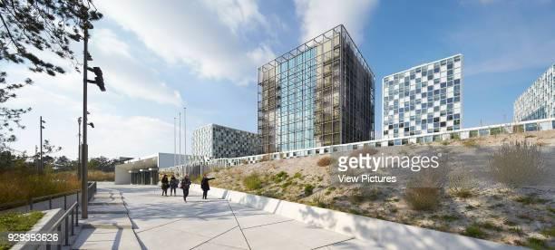 Oblique elevation of ICC complex with dunes. International Criminal Court Den Haag, Den Haag, Netherlands. Architect: Schmidt Hammer & Lassen Ltd,...