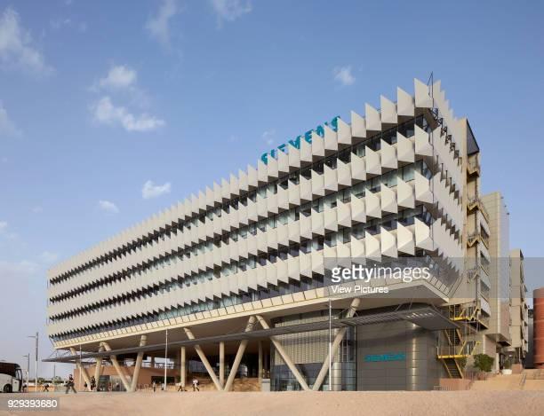 Oblique elevation towards main entrance. Siemens Masdar, Abu Dhabi, United Arab Emirates. Architect: Sheppard Robson, 2014.