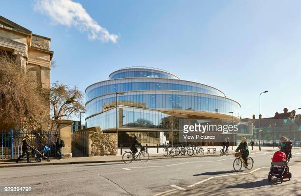 Oblique elevation with street and context. The Blavatnik School of Government at the University of Oxford, Oxford, United Kingdom. Architect: Herzog...