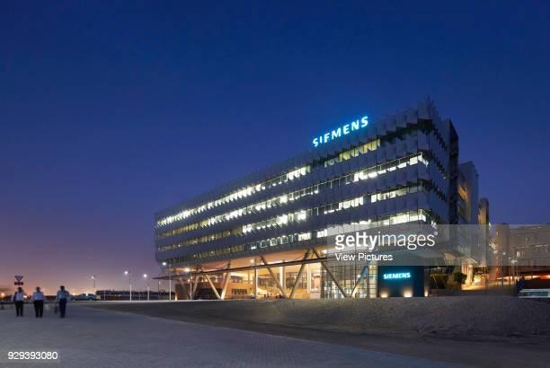 Oblique night elevation. Siemens Masdar, Abu Dhabi, United Arab Emirates. Architect: Sheppard Robson, 2014.