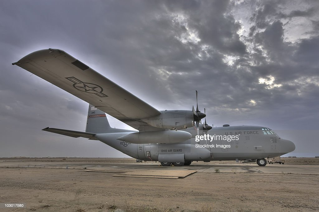 Oblique view high dynamic range image of a U.S. Air Force C-130 Hercules parked on the tarmac at COB Speicher Iraq : Stock Photo
