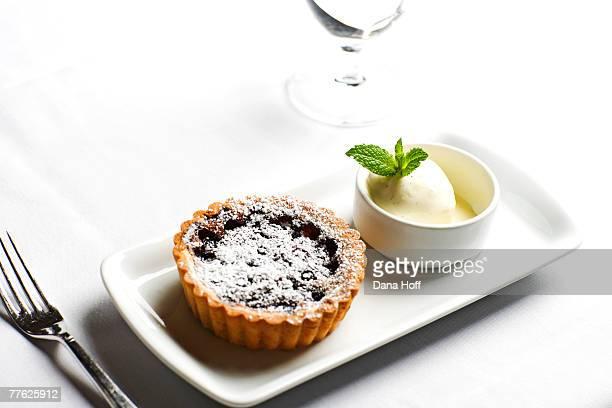 Oblong dish with fruit tart and vanilla ice cream