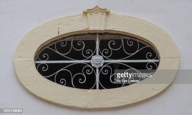 oblong window in faro old town - faro city portugal stock photos and pictures