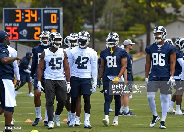 Obo Okoronkwo John Kelly Gerald Everett and Kendall Blanton of the Los Angeles Rams listen to instructions during the first day Organized Team...