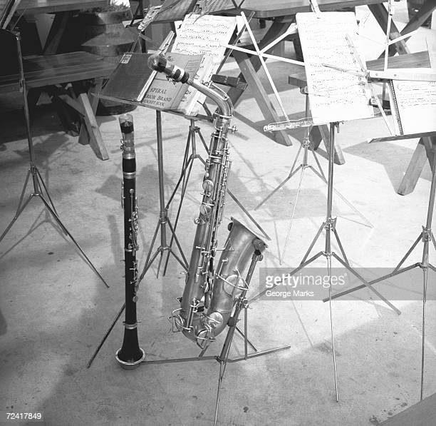 oboe and saxophone with music sheets , (b&w) - oboe stock-fotos und bilder
