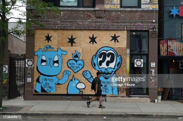 Obras de arte que cubren fachadas cerradas a lo largo de 18th St., en el barrio de Pilsen, el jueves 4 de junio de 2020.