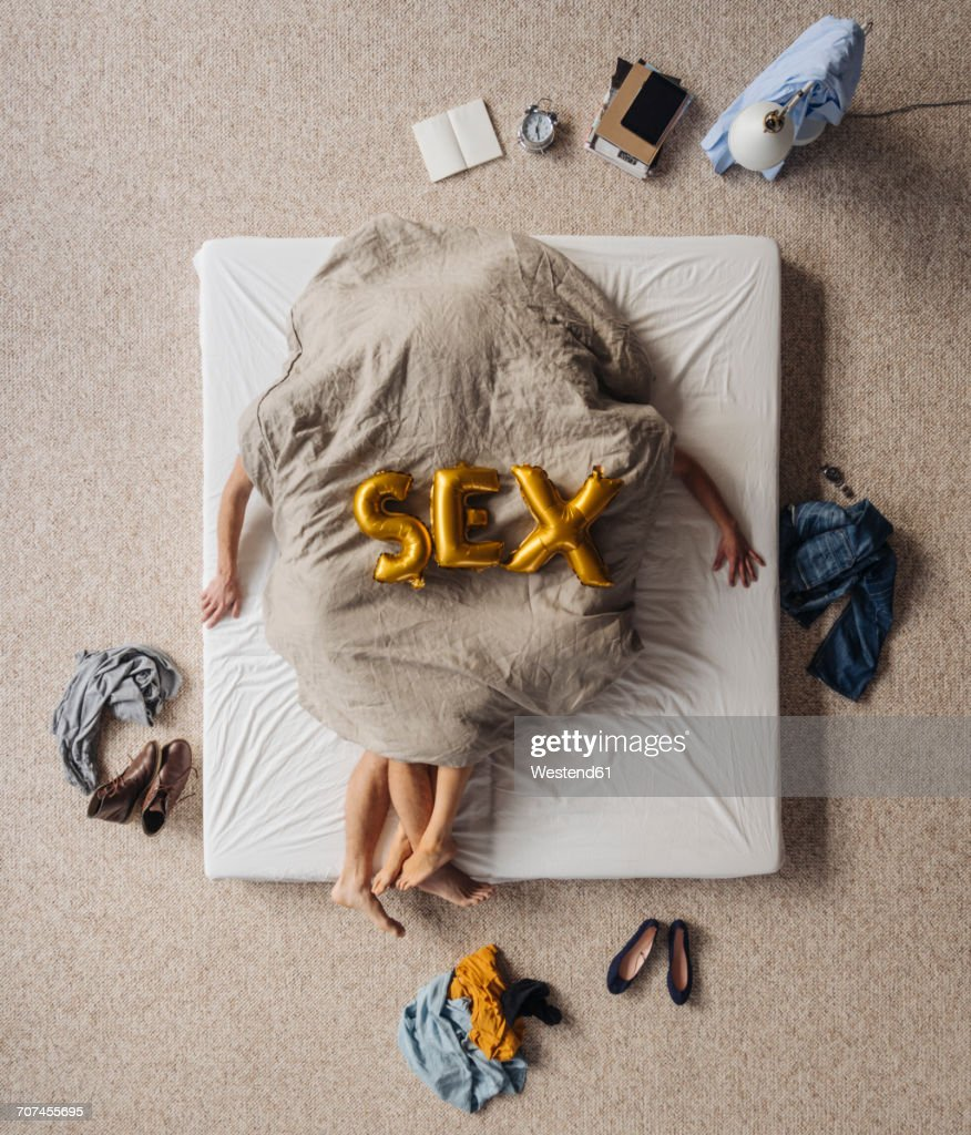 Obscured couple having sex in bed, top view : Stock Photo