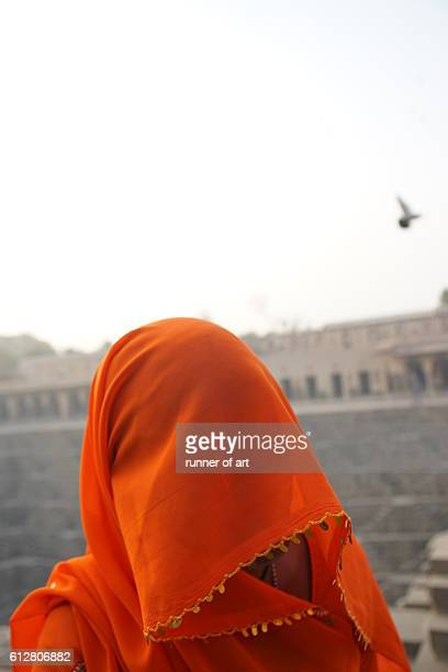 obscured face - stepwell stock photos and pictures