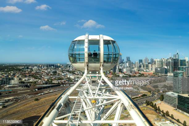 observation ferris wheel in docklands district in melbourne, australia. - international landmark stock pictures, royalty-free photos & images