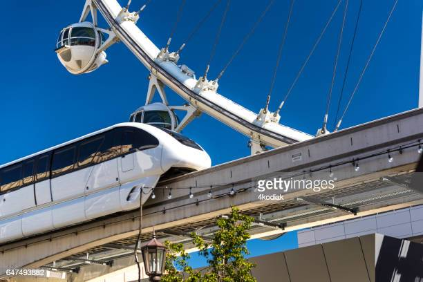 observation wheel, high roller, in las vegas  with monorail paassing by in front - monorail stock pictures, royalty-free photos & images