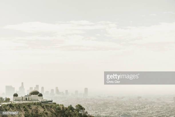 Observatory and city skyline in hazy sky, Los Angeles, California, United States